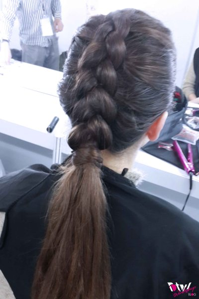 "First Show- International Brand Collection Show 1 ""Slick French Braid finished a loose textured ponytail"" is the reference by the client"